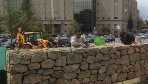 Stone wall in front of building